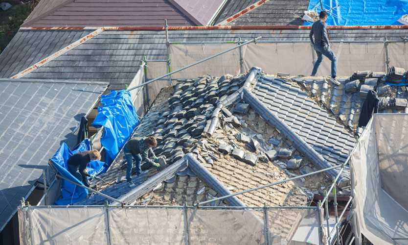 Rooftop repairs in Japan after a typhoon