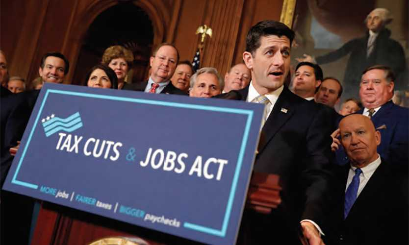 Former Speaker of the House Paul Ryan, foreground, spearheaded the Tax Cuts and Jobs Act, which has affected some captives.