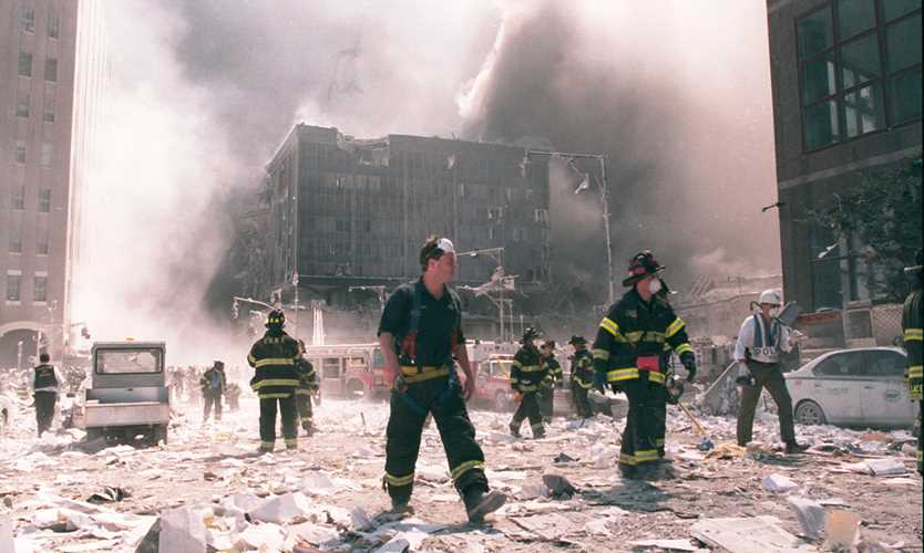 New York City firefighters work near the area known as Ground Zero after the collapse of the Twin Towers on Sept. 11, 2001.