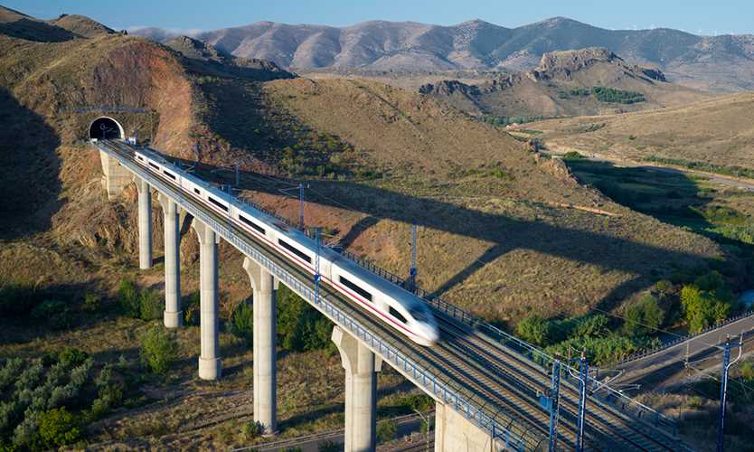 Train crossing a viaduct in Spain
