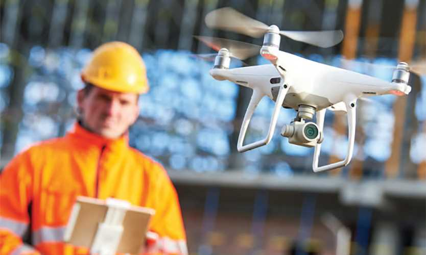Construction worker with drone