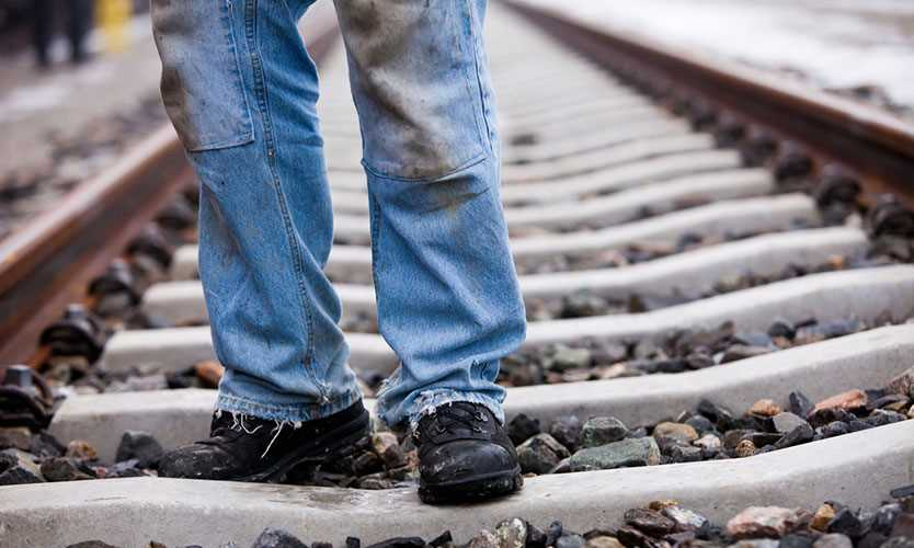 Railroad worker on tracks