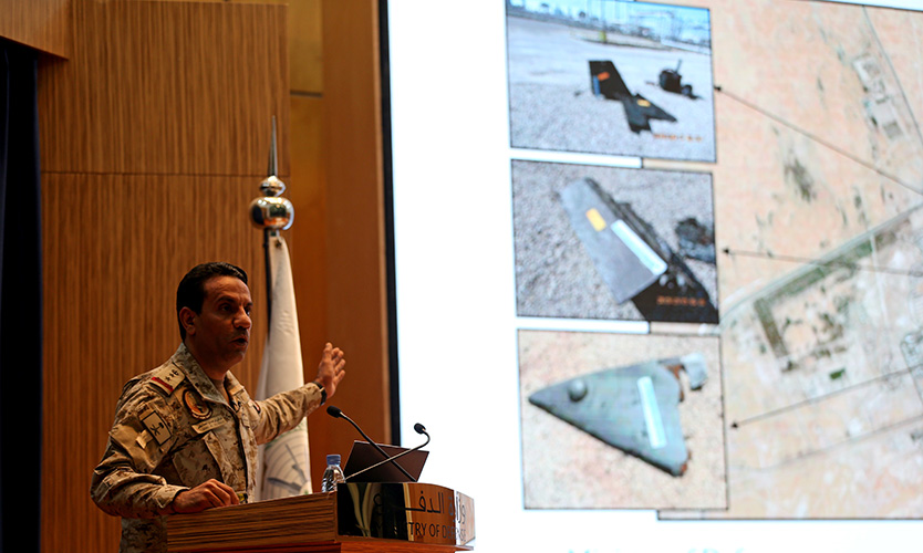 Saudi defense ministry spokesman Colonel Turki Al-Malik displays on a screen drones that the Saudi government says attacked an Aramco oil facility, during a news conference in Riyadh, Saudi Arabia, on Sept. 18, 2019.