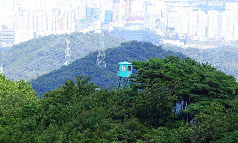 Forest fire watch tower on the ridge of Namhansanseong mountain castle in southeast Seoul, Korea