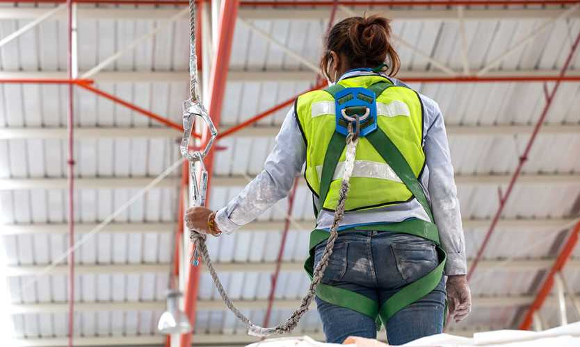Woman wearing safety harness