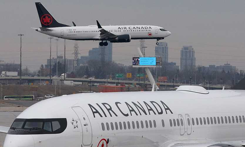 An Air Canada MAX 8 lands at Toronto Pearson International Airport