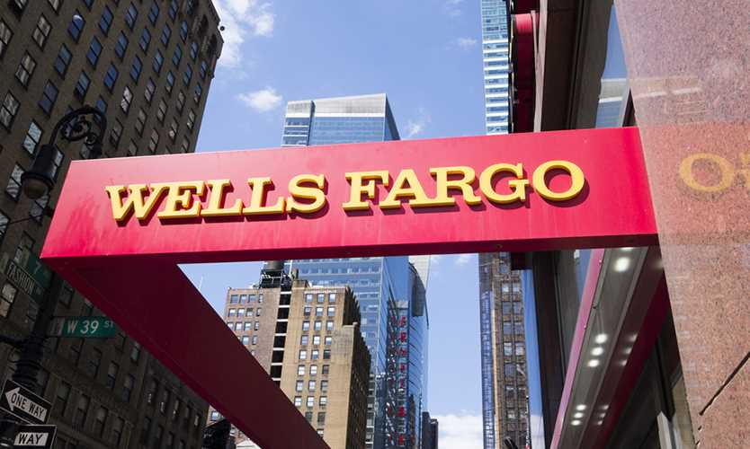 Fed orders Wells Fargo to halt growth over compliance issues