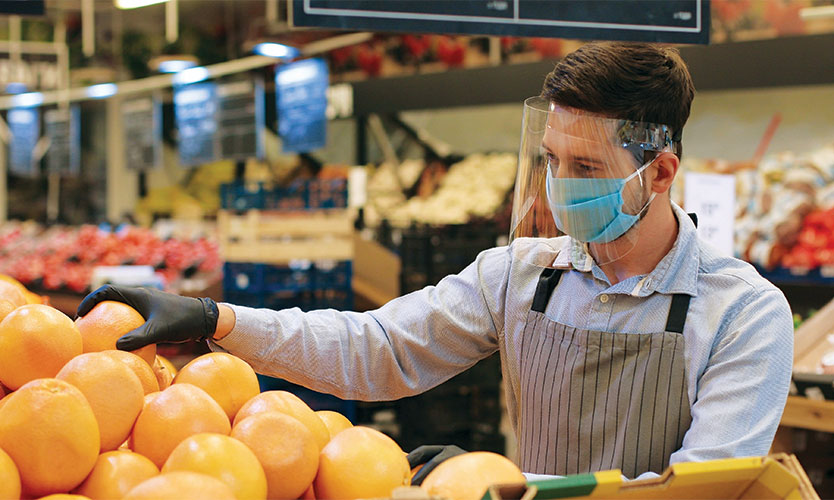 masked grocery worker
