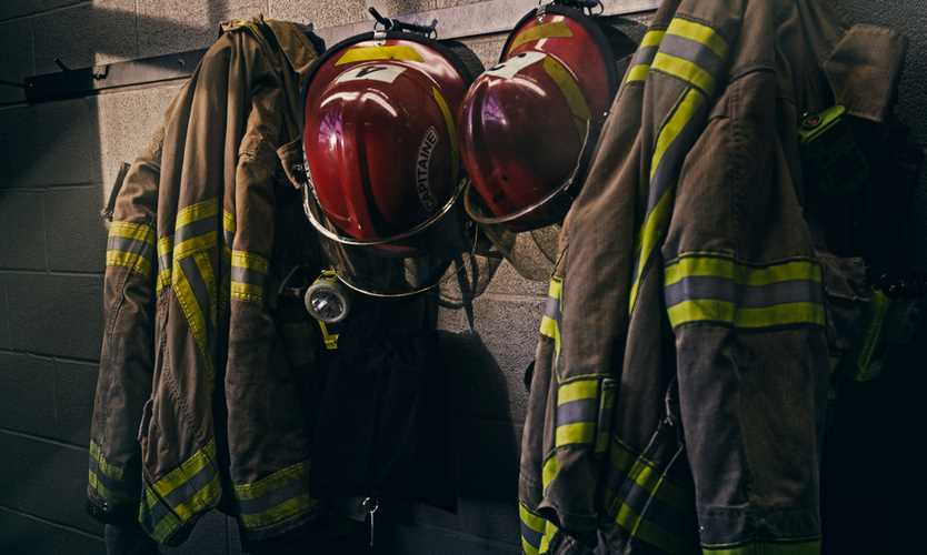 AIG, Arch fined over firefighter insurance premium rates