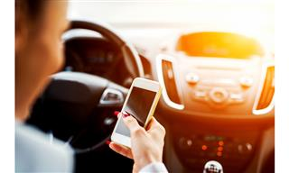 Liberty Mutual net income sinks higher auto losses distracted driving safety features