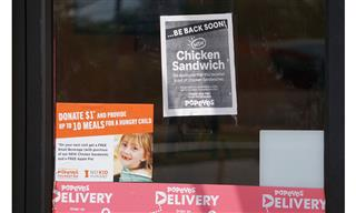 A Popeye's Restaurant posts sign that it's sold out of its new chicken sandwich.