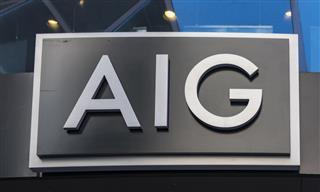 AIG reports third-quarter loss