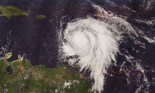 Hannover Re Talanx profit warning hurricanes Harvey Irma Maria Mexico quake