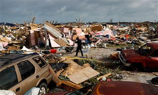 A man walks among debris at the Mudd neighborhood, devastated after Hurricane Dorian hit the Abaco Islands in Marsh Harbour, Bahamas, on Sept. 6, 2019.