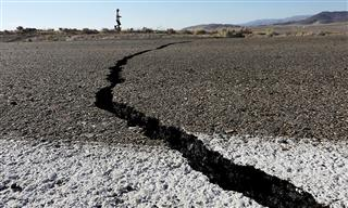 Fissures that opened up under a highway during a powerful earthquake that struck Southern California are seen near the city of Ridgecrest on July 4.