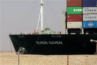 Suez Canal blames ship's grounding on speed, rudder