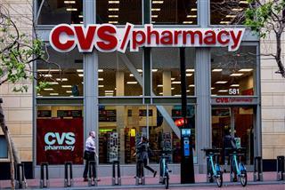 CVS to buy pharmacy services provider Omnicare for $10.1 billion