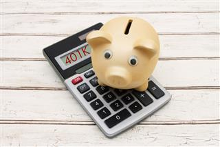 Employee 401(k) balances dip but hover near record levels
