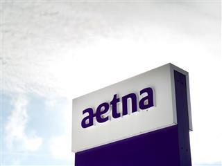 Health insurer Aetna Inc.'s profit drops in third quarter of 2015