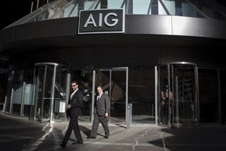 AIG results show continued improvement, analysts say
