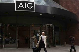 No quick fix for what ails AIG Peter Hancock Carl Icahn John Paulson fourth-quarter loss mortgage unit spinoff