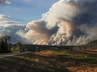 Convoy leads Canada fire evacuees through burning city to safety