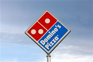 Domino's Pizza franchisee lawsuit wage theft underreporting employee pay McDonald's Attorney General Eric Schneiderman