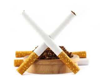 Insurer Axa global tobacco assets sale Thomas Buberl British American Tobacco Imperial Brands cancer