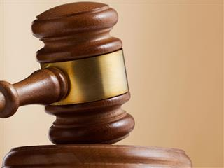 Court overrules comp rules in job murder suit