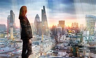Woman overlooking London financial district