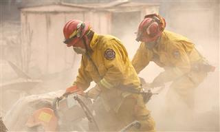 Cal Fire firefighters battle the Camp Fire blaze in Paradise, California.