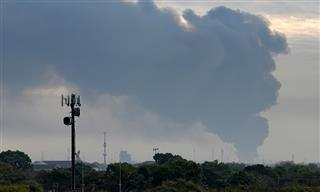Smoke rises from a fire burning at the Intercontinental Terminals Co. east of Houston.