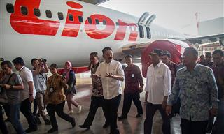 Founder of Lion Air Group Rusdi Kirana walks with Indonesia's Transport Minister Budi Karya Sumadi and Indonesia's Coordinating Minister of Economic Affairs Darmin Nasution in August 2019