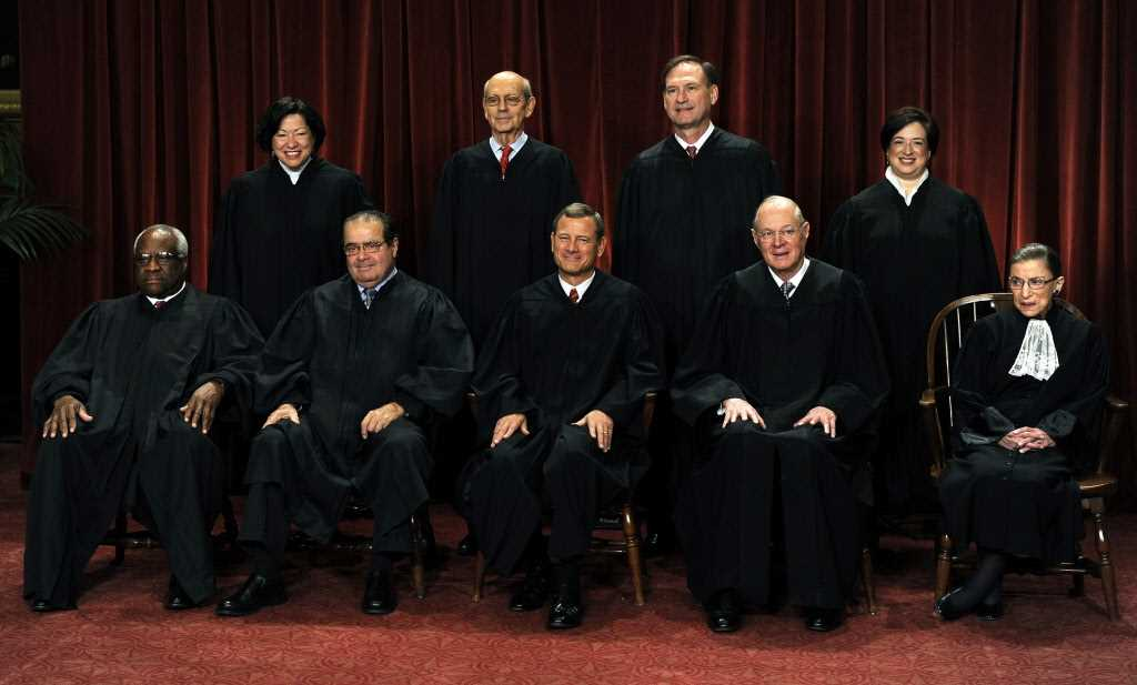 Justices ask tough questions on health care reform law individual mandate