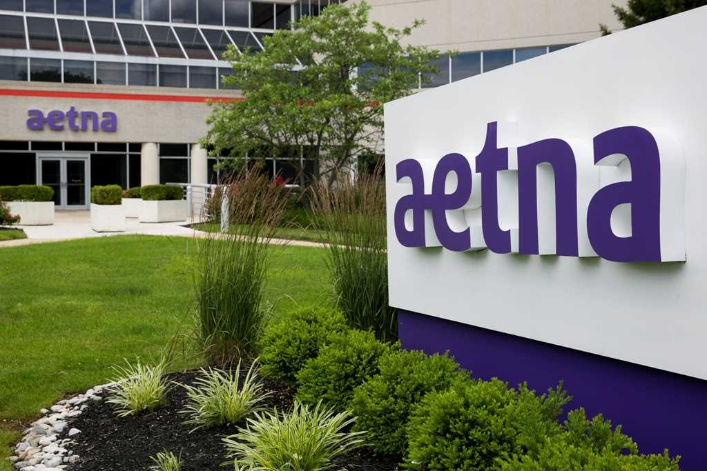 Aetna hires more lobbyists to ensure Humana deal