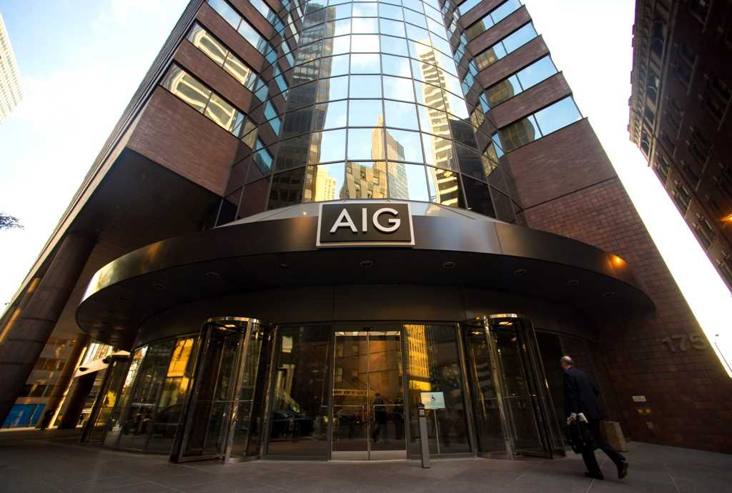 AIG freezes pension plans, sweetens 401(k)