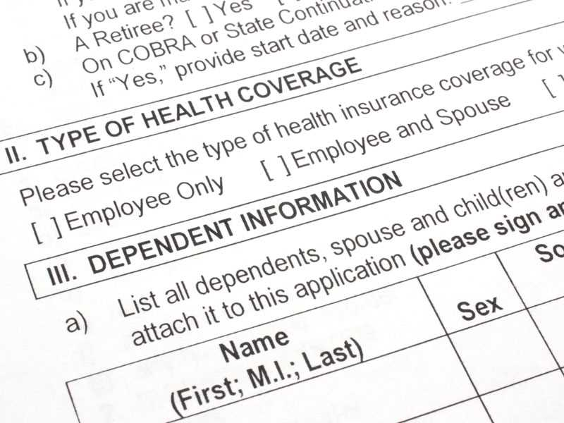 More employers charging extra for spouse when other health coverage available