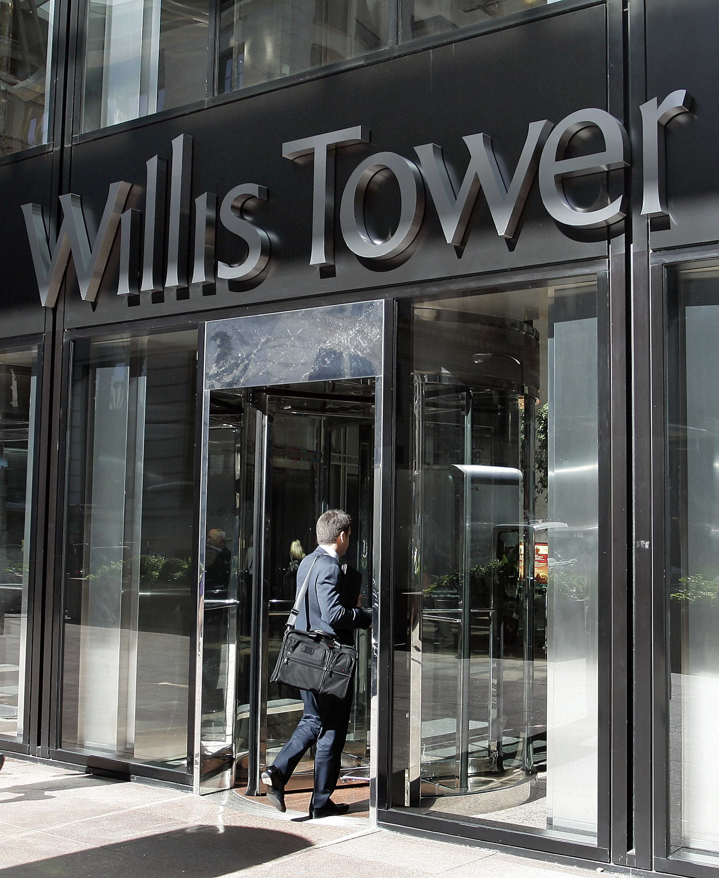Willis puts employees on leave during investigation into commissions, fees