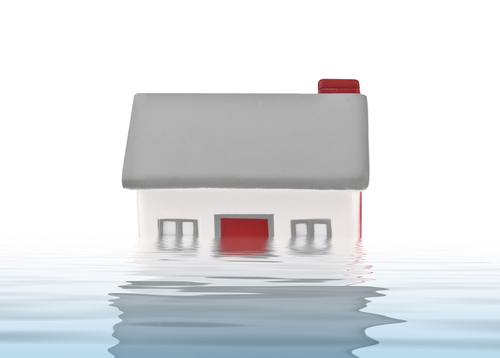 Obama signs measure that rolls back many 2012 flood insurance reforms