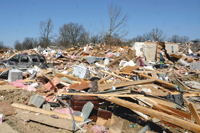 Tornadoes hit several states, losses mount
