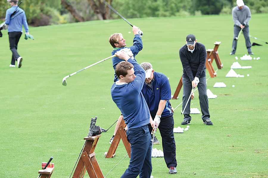Rain cuts short fun golf outing to benefit Spencer Foundation