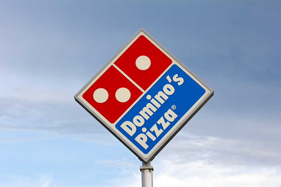 Official sues Domino's over alleged wage theft