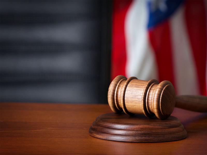 Bikini-related retaliation lawsuit reinstated on appeal