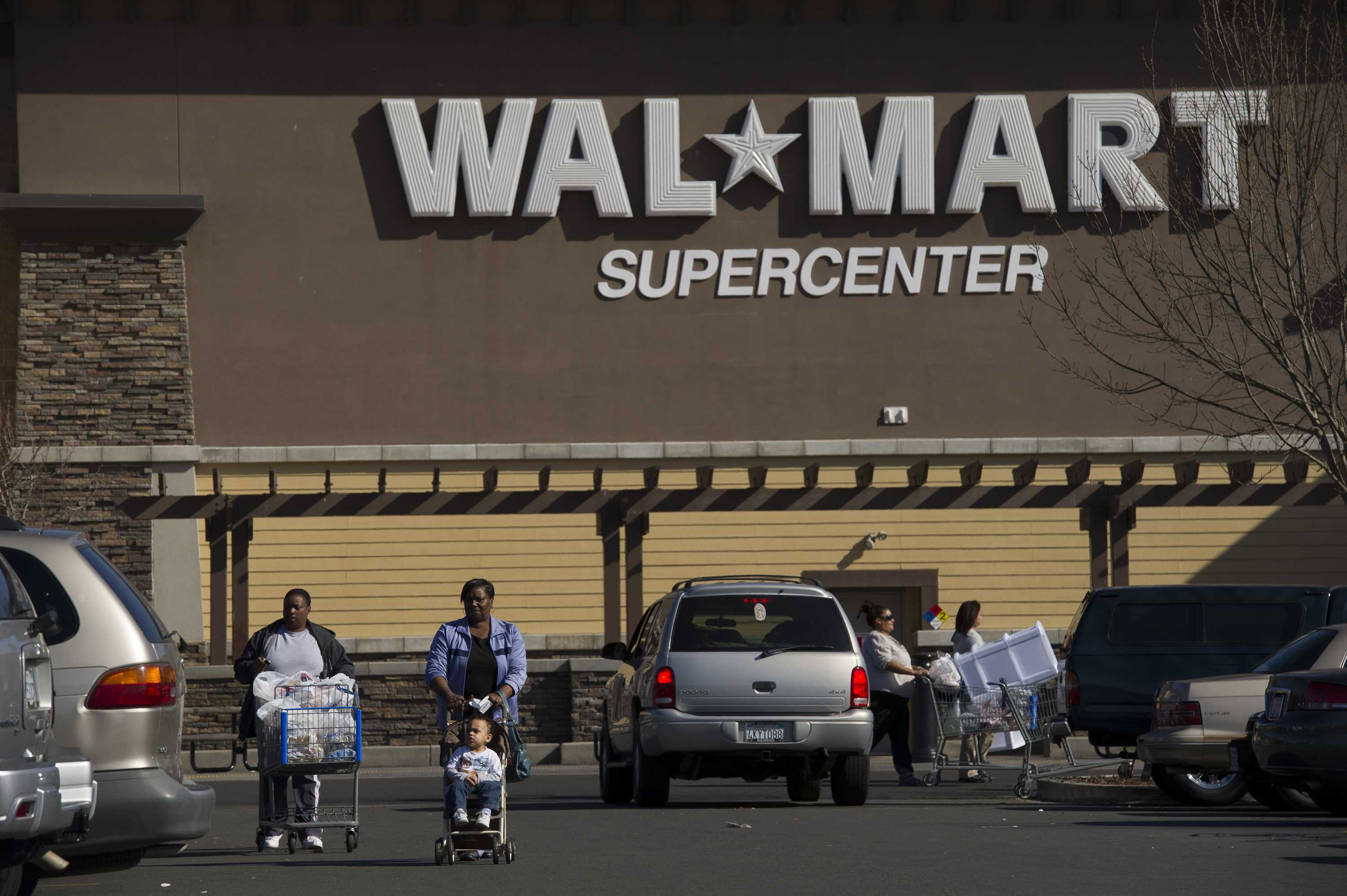 Hearing set in settlement by Wal-Mart, others in workers comp class action