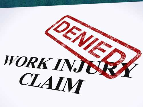 No benefits for manager injured intentionally jumping off loading dock