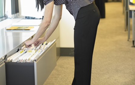 Worker due comp benefits for injury from filing cabinet struggle