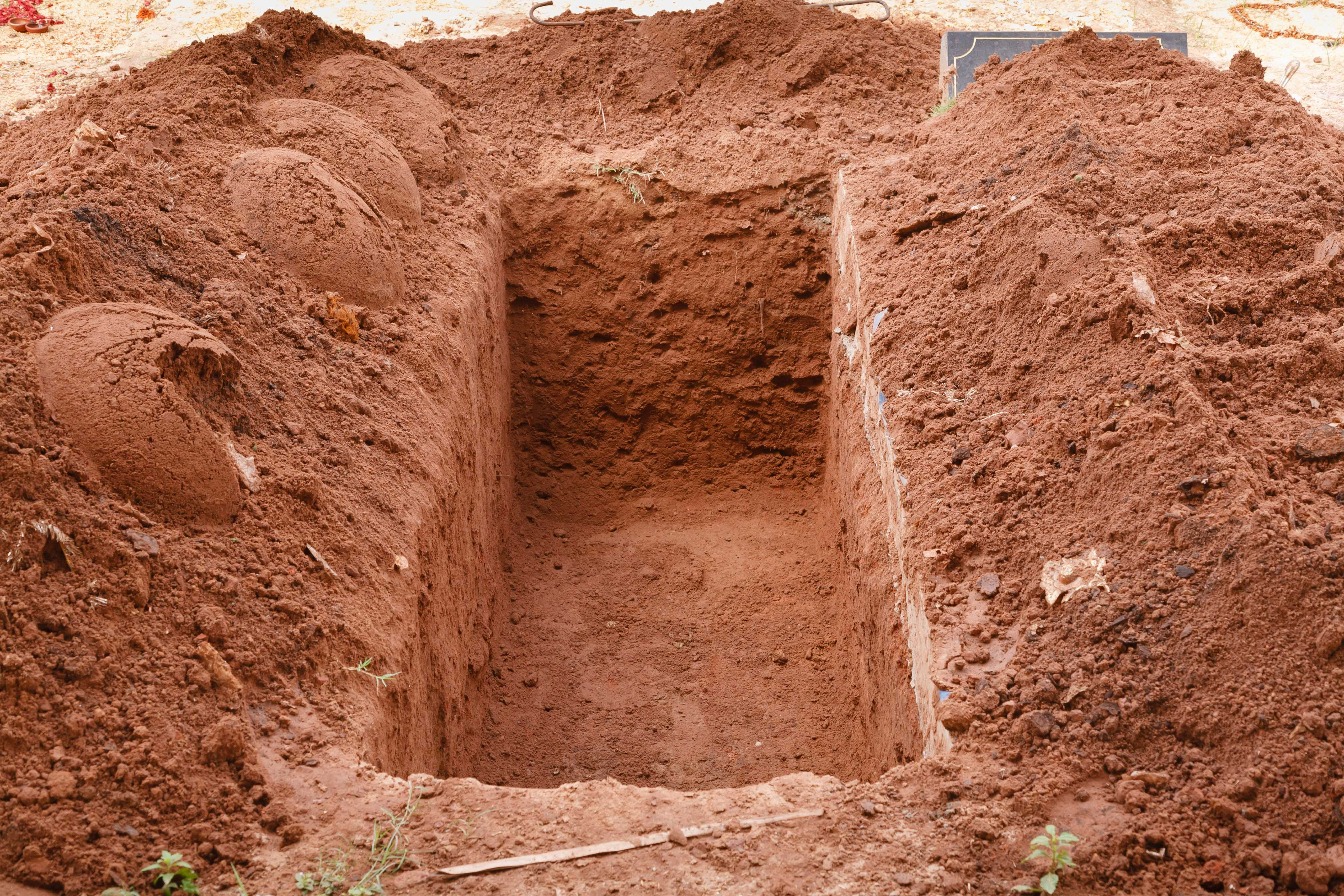 Cemetery group faces fine after gravedigger partially buried