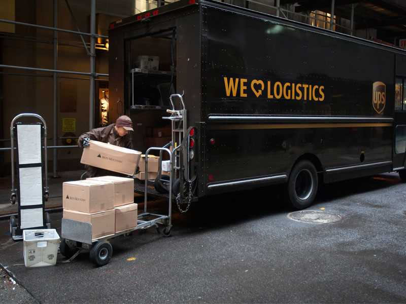 UPS driver gets comp for heavy-lifting injury, but negligence claim denied