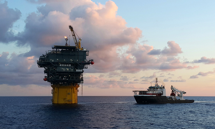 A supply ship approaches an oil platform in the Gulf of Mexico.