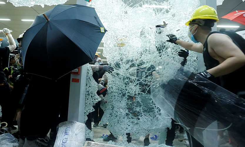 Protesters break the windows of the Legislative Council building on the anniversary of Hong Kong's handover to China in Hong Kong, China July 1, 2019.